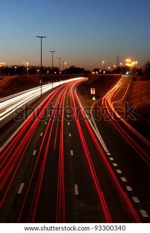 A highway exit at night - stock photo