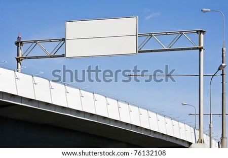 A highway of a bridge. A blank highway sign with room for your text. - stock photo