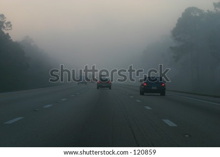 A highway on a misty morning looks like driving into oblivion. - stock photo