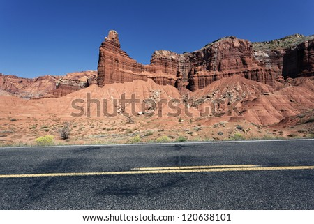 A highway rolling through red rock canyons - stock photo