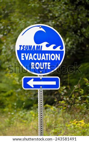 A highway sign marking Tsunami Evacuation Route along the coast of Oregon                                   - stock photo