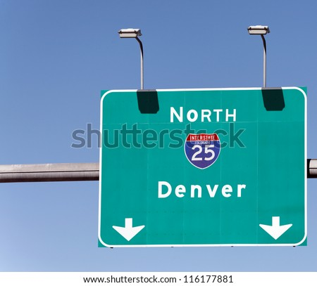 A highway sign pointing the way to Denver, Colorado. - stock photo