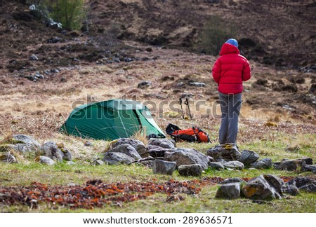 A hiker and their pitched tent at Barrisdale Bay in the Scottish Highlands. - stock photo