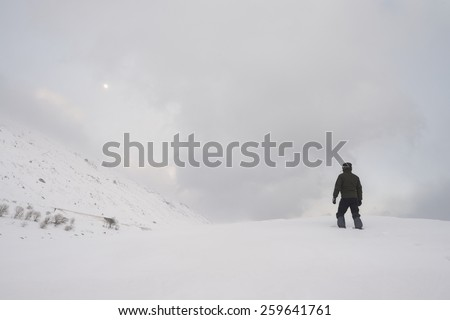 a hiker in the snow - stock photo