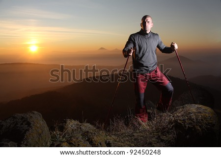 A hiker on the top of mountain - stock photo
