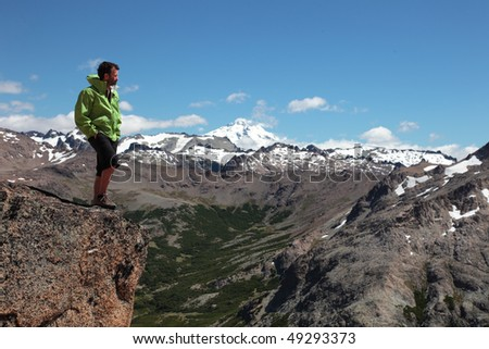A hiker walks through the wilderness of Patagonia. - stock photo