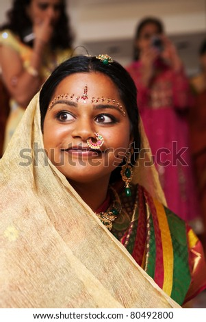 A Hindu bride during a pre=wedding ceremony - stock photo