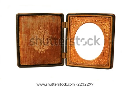 A hinged Daguerreotype frame from the 19th century.  Isolated on white. - stock photo
