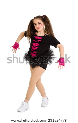 A Hip Hop Girl in Pigtails and Recital Costume - stock photo