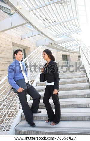 A hispanic man and african business woman at office talking - stock photo