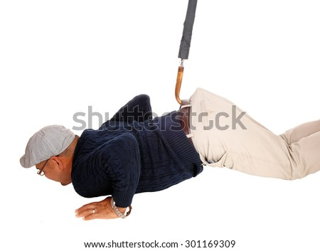 A Hispanic man with a had lying on the floor and get's pulled up with