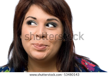 A Hispanic woman isolated over white with a mischievous look on her face. - stock photo