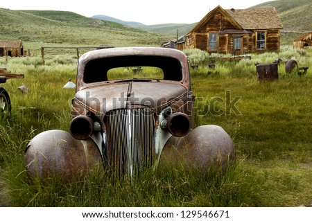 A historic car in Bodie Ghost Town - stock photo