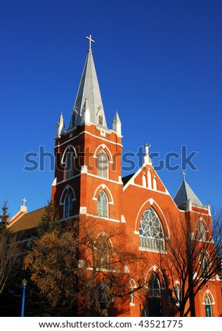 A historic catholic church under the blue sky, downtown Edmonton, Alberta, Canada - stock photo
