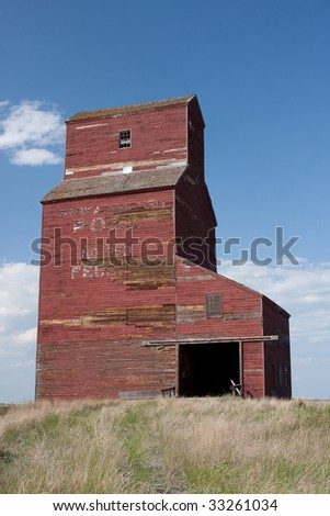 A historic grain elevator in Feudal, Saskatchewan on the Canadian prairies. - stock photo