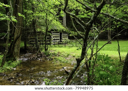 A historic log cabin in the forest at Smoky Mountain National Park - stock photo