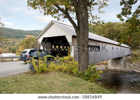 A historic New England covered bridge located in the United States. - stock photo