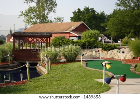 A hole at a miniature golf course - stock photo