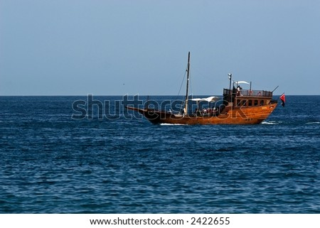 A holiday cruise on a dhow,  Muttrah, Oman - stock photo