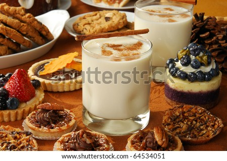 A holiday dessert buffet lined with delicious gourmet tarts, cookies, pies, and more - stock photo