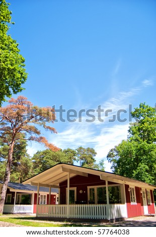 A holiday lodge at a caravan park located in rural woods near Torekov in Sweden. - stock photo