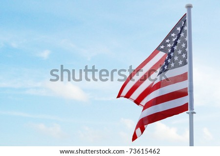 A holiday us flag on sky - stock photo