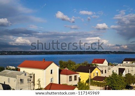 a holiday village at the Dnieper river bank near to Kherson (Ukraine) on autumn day - stock photo