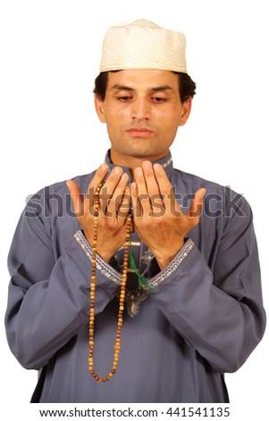 A holy man praying for the salvation/Ramadan Kareem - stock photo