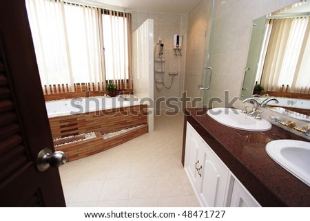 A home bathroom with interior decorations. - stock photo