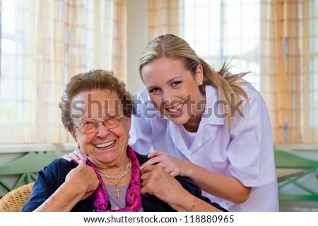 a home care nurse visits a patient - stock photo