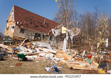 A home heavily damaged by an F2 tornado that swept through Oregon Twp in Lapeer County, MI on March 15, 2012. The house was lifted from its foundation. This photo was taken the next day.