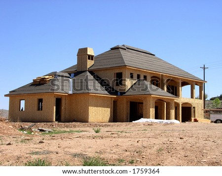 a home in construction phase - stock photo