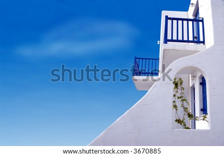 A home in the Greek Islands with a beautiful blue sky.