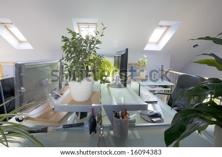 A home office in a converted loft - stock photo