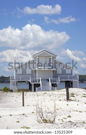 A home on the beach. - stock photo