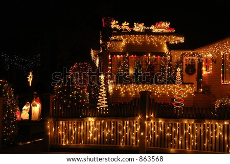 A home with x-mas lights galore in Christmas celebration. - stock photo