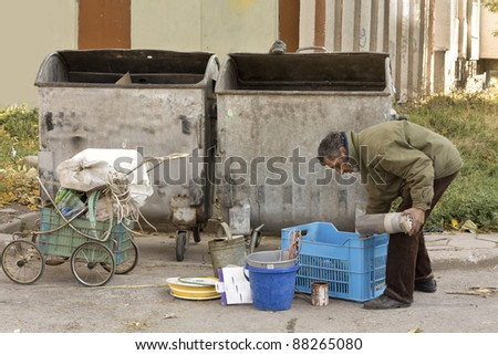 A homeless man collecting garbage - stock photo