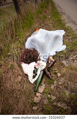 A homeless person sleeping in the ditch - stock photo