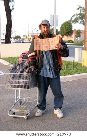 a homeless person with a cardboard sign, showing first hand the plight of the homeless in california