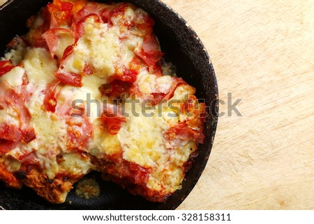 A homemade Italian style pizza on the old pan represent food and Italian cuisine concept related idea.