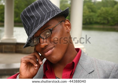 A homosexual man posing with his hand on the side of his face - stock photo