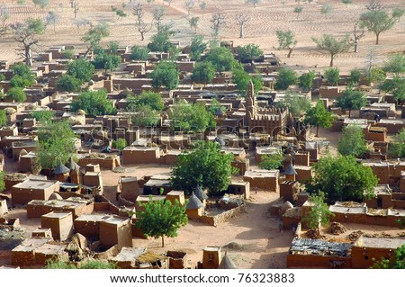 A horizontal close up of a Dogon village from below the Bandiagara cliff in Mali - stock photo