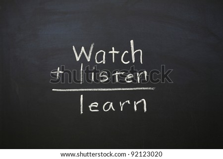 A horizontal color photograph of the statement Watch Listen and Learn written on a chalkboard. - stock photo