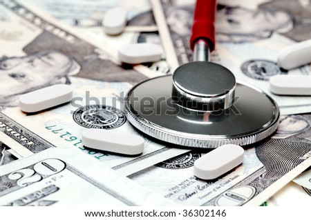 A horizontal image of a stethoscope and pills on American currency