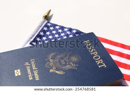 A horizontal image of an American passport on an American flag - stock photo