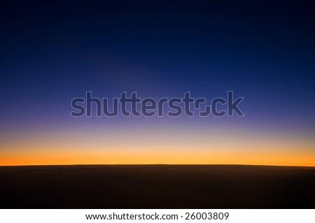 A horizontal sunrise - stock photo