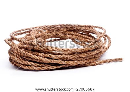 A horizontal view of a coil of rope on white - stock photo