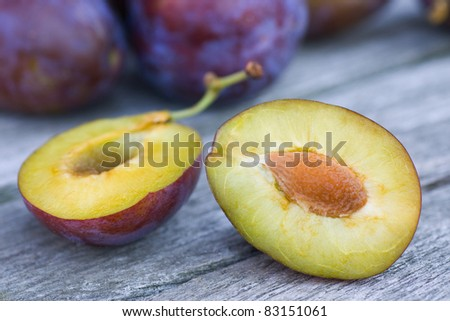 A horizontal view of a halved plum - stock photo