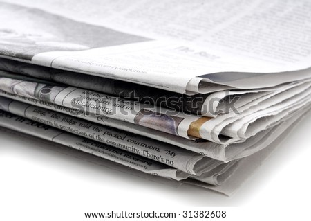 A horizontal view of a stack of folded newspapers - stock photo