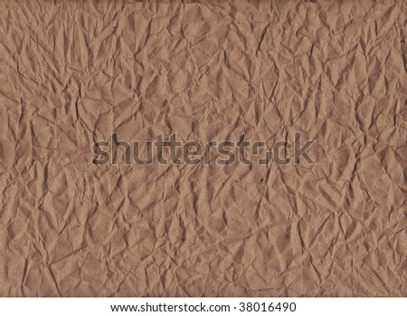 A horizontal view of crumpled kraft paper - stock photo